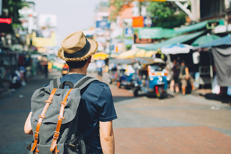 A travel blogger in an exotic locale. Photo courtesy of Shutterstock